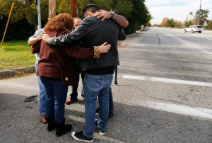 Local residents as they wait to return to their homes near the scene of the investigation of an SUV where two suspects were shot by police following a mass shooting in San Bernardino, California December 3, 2015.  Authorities on Thursday were working to determine why Syed Rizwan Farook 28, and Tashfeen Malik, 27, opened fire at a holiday party of his co-workers in Southern California, killing 14 people and wounding 17 in an attack that appeared to have been planned. REUTERS/Mike Blake - RTX1X2NT