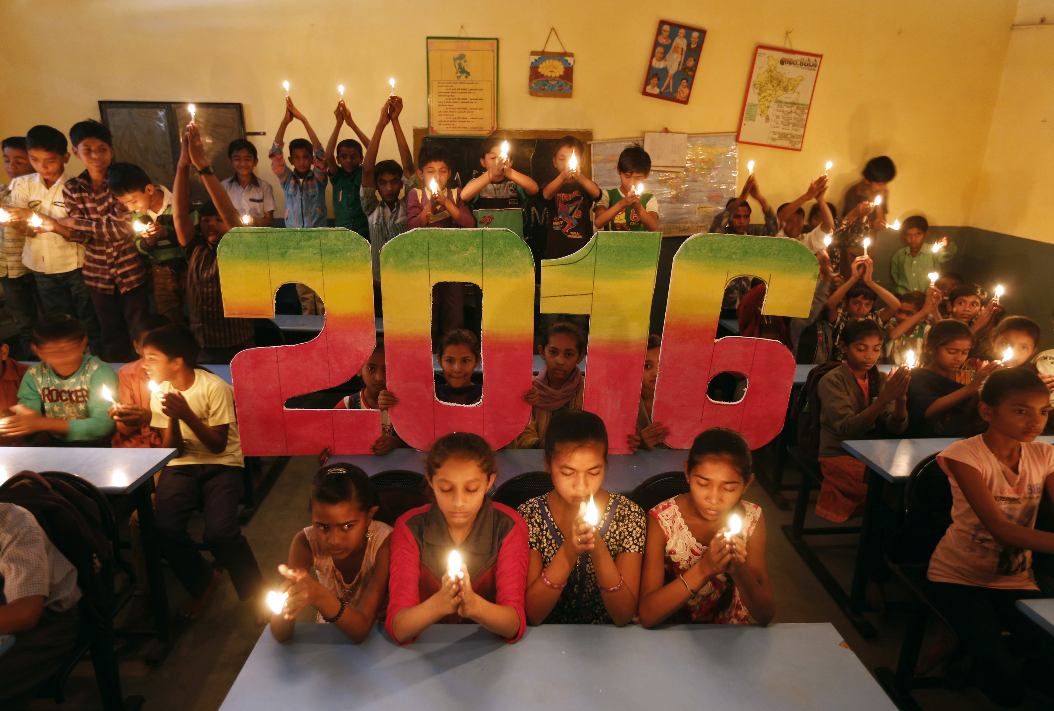 School students offer prayers for the world peace in the upcoming year of 2016 in Ahmedabad, India, on Dec. 31, 2015. Photo by Amit Dave/Reuters
