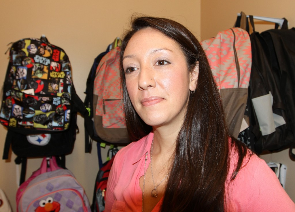 Stephanie Gromek works as a community resource coordinator for the Church World Service in Lancaster. Local residents have donated supplies, including backpacks, furniture and toiletries, for the refugees. Photo by Larisa Epatko