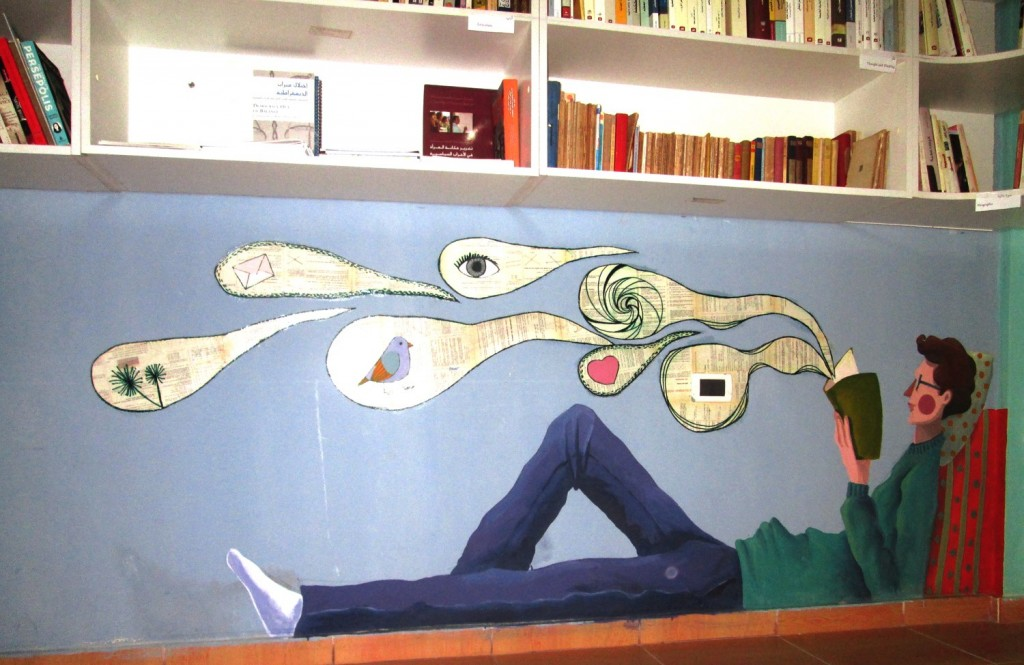 Brisly painted this mural inside a public library for Palestinian and Syrian refugees in Beirut. Photo by Diala Brisly