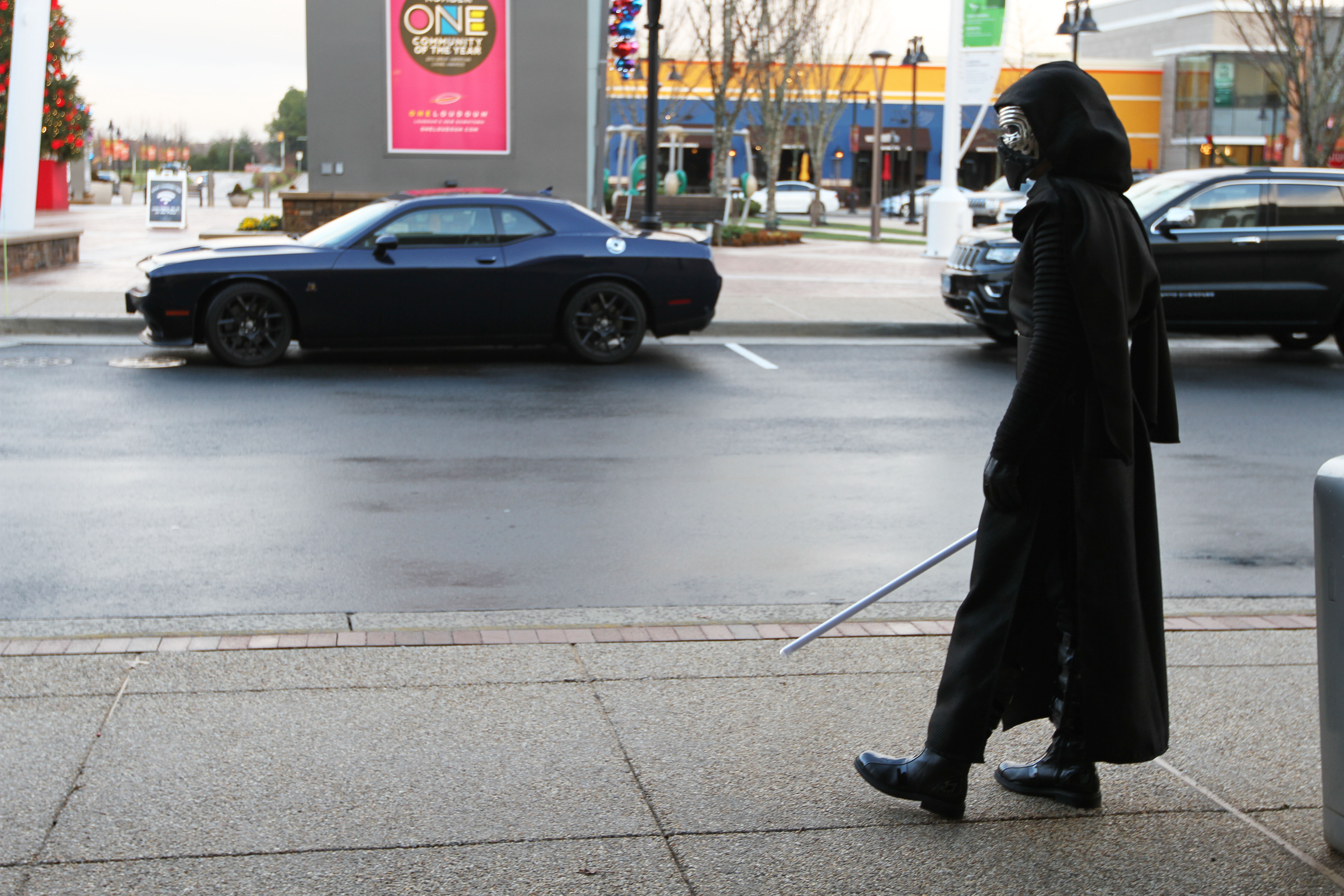 "Kylo Ren, a ""dark warrior strong with the force,"" waits for visitors to attend the ""Star Wars: Episode VII The Force Awakens"" premiere at the Alamo Drafthouse Cinema in Ashburn, Va., on Dec. 17. Photo by Larisa Epatko"