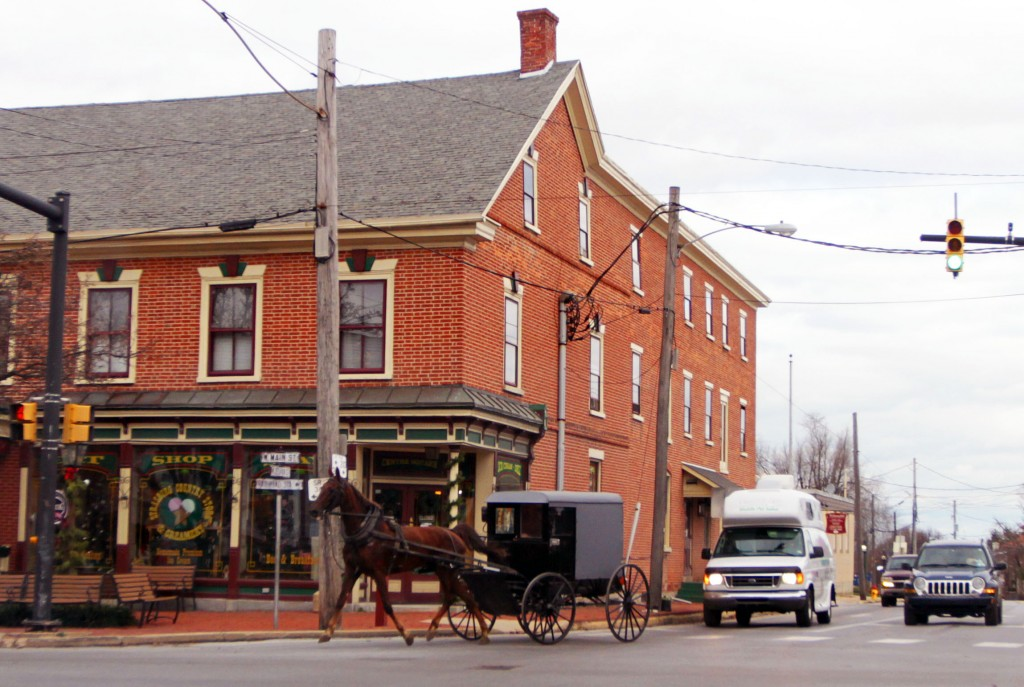 An Amish horse and buggy ride through town in Lancaster County. Photo by Larisa Epatko