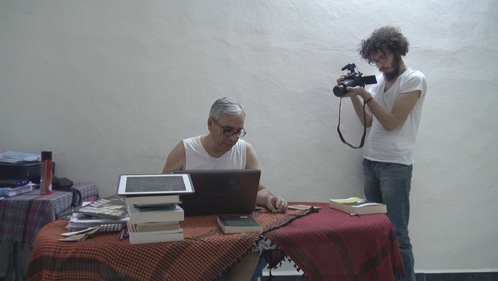 "Syrian intellectual Yassin al-Haj Saleh, left, and photographer Ziad al-Homsi, right, appear in a scene from Ali Atassi's ""Our Terrible Country."" The film depicts Saleh's journey from Douma to Raqqa, the stronghold of the Islamic State, before he moves to Istanbul. Photo courtesy of Ali Atassi"