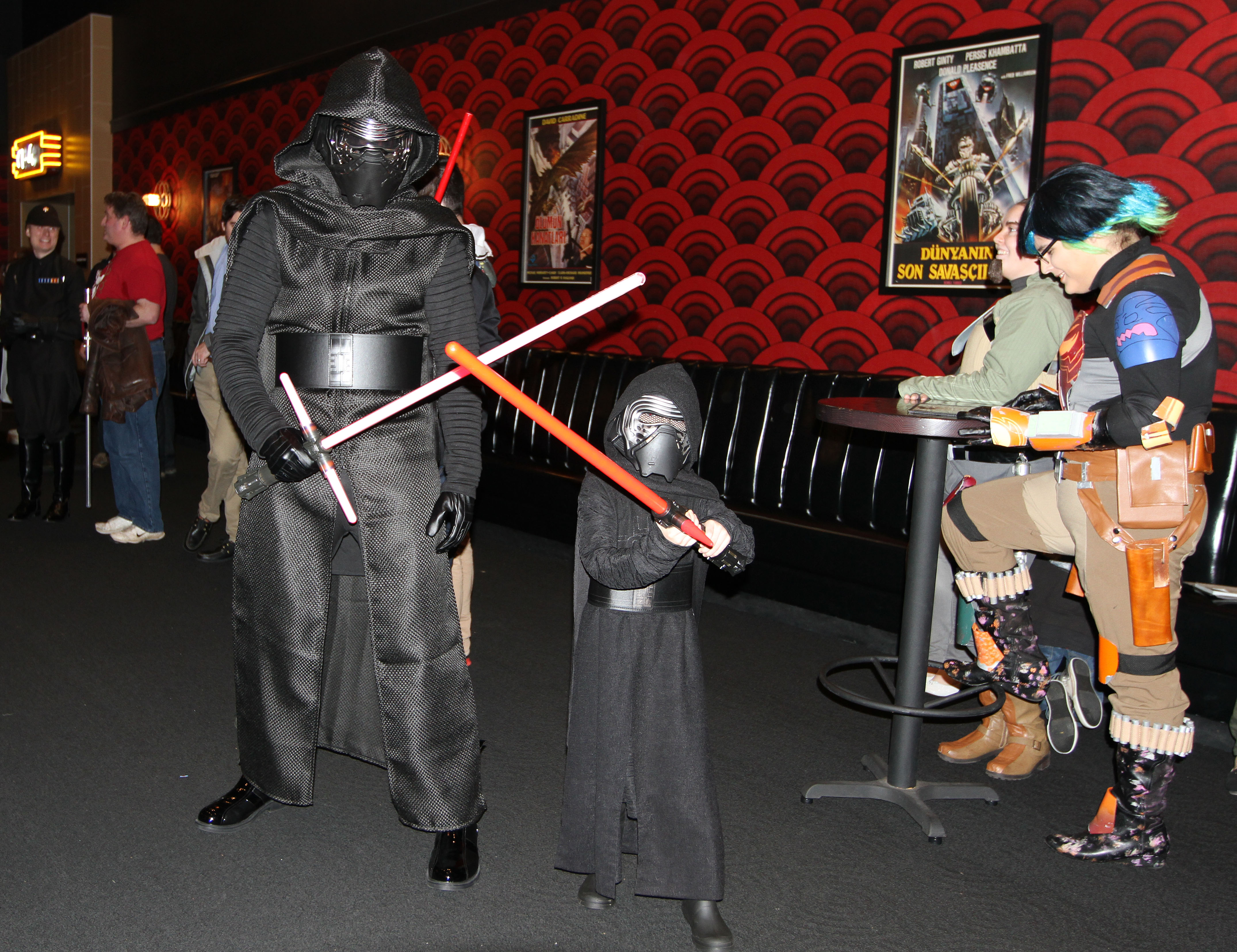"Big Ren and little Ren cross light sabers at the premiere of ""Star Wars: Episode VII The Force Awakens"" at the Alamo Drafthouse Cinema in Ashburn, Va., on Dec. 17. Photo by Larisa Epatko"