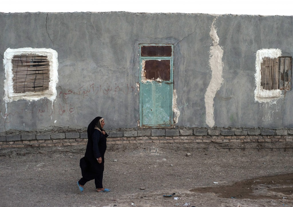 The temperature is unbearably hot. Before, when the lake had water, the wind would work like a natural air conditioning unit for the villages, blowing through the windows. Now however, the wind is hot and carries sand with it everywhere. Consequently, the villagers have boarded everything up. Photo by Mahdi Barchian