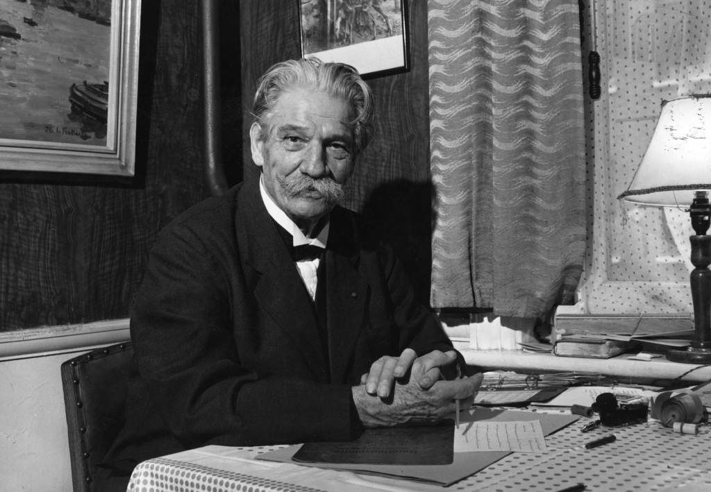 Philosopher and musician Dr. Albert Schweitzer, sitting at his desk in a London restaurant, around 1955. Photo by Hulton Archive/Getty Images
