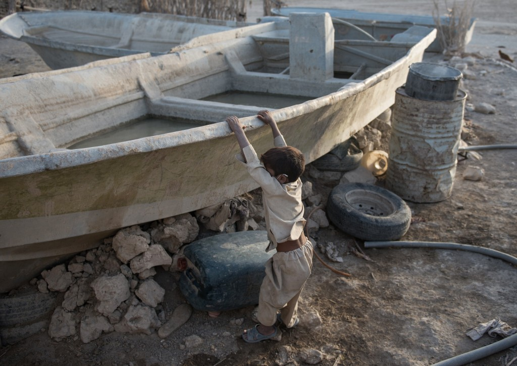 Without water, the fishermen have converted their boats into water tanks.  Photo by Mahdi Barchian