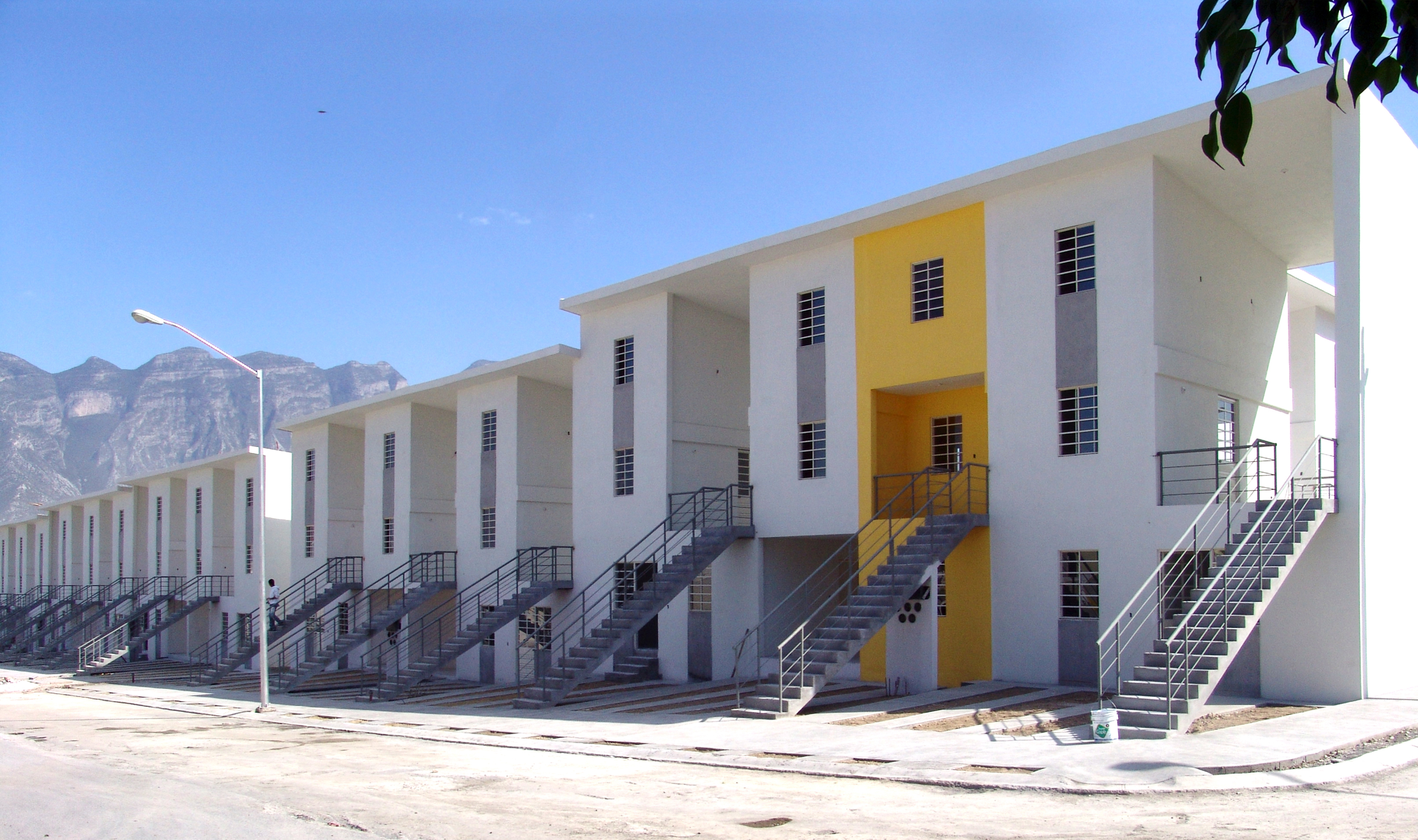 These low-income housing units, designed by Araveno, were built in 2010 in Monterrey, Mexico. The houses were constructed to seem half-completed, a choice meant to encourage people to add their own contributions to the structure. Photo by Ramiro Ramirez