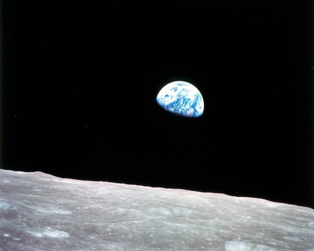 The Earth is seen rising above the lunar horizon from the Apollo 8 spacecraft on Christmas Eve, Dec. 24, 1968. Photo by NASA