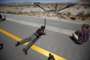 A militiamen aims his weapon in 2014 in  support of Nevada rancher Cliven Bundy who had been letting his animals graze illegally on federal land for over 20 years.   Photo By Jim Urquhart/Reuters