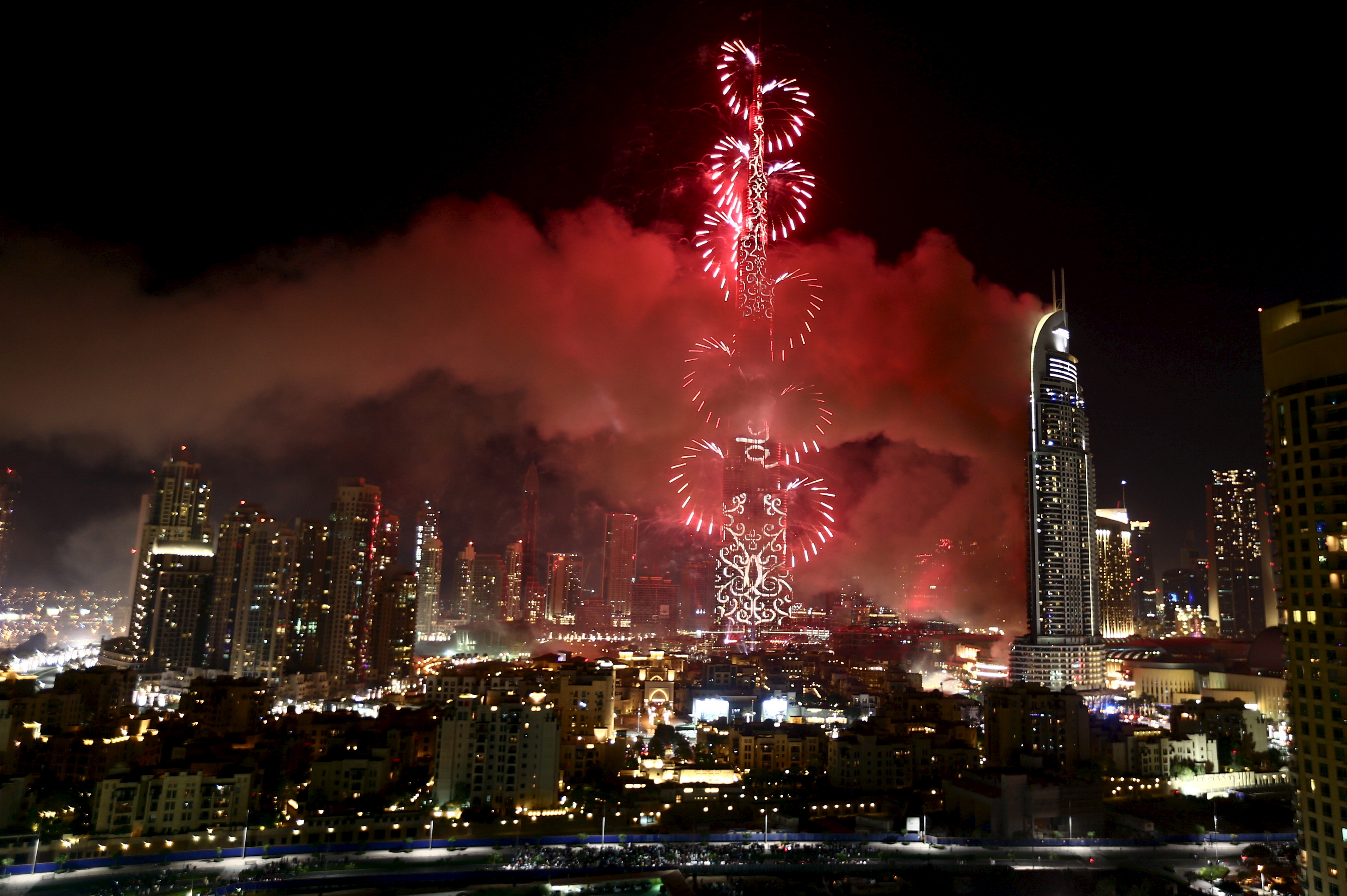 The Address Downtown Dubai hotel and residential block is seen engulfed by fire as fireworks explode over the Burj Khalifa, the tallest building in the world, during the New Year celebrations in Dubai. Photo by Hassan Al Rasi/Reuters