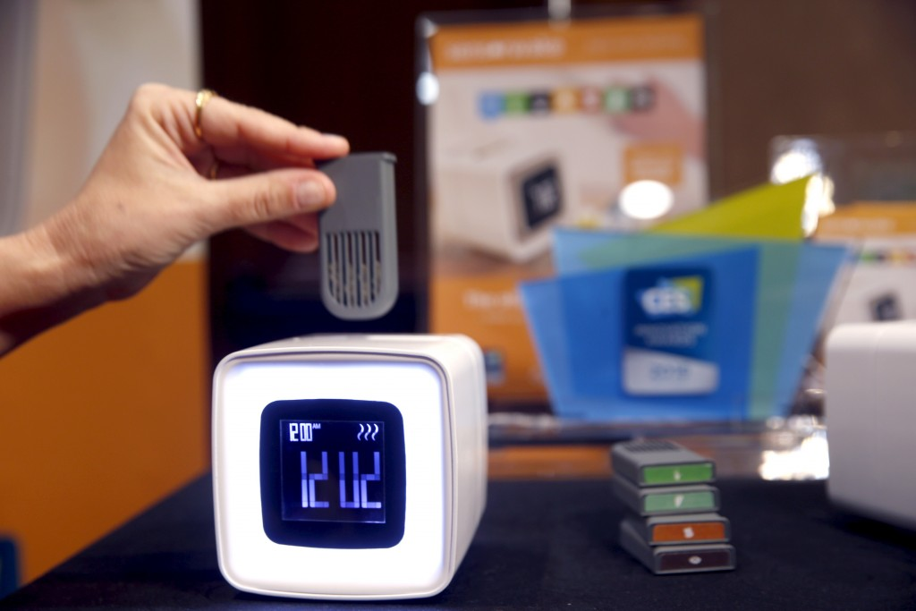"An aroma module is inserted into a Sensorwake alarm clock during ""CES Unveiled,"" a preview event of the 2016 International CES trade show, in Las Vegas, Nevada January 4, 2016. Photo by Steve Marcus/Reuters."