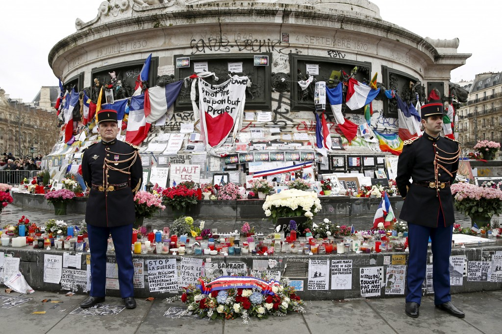 French Republican guards stand during a ceremony at Place de la Republique square to pay tribute to the victims of last year's shooting at the French satirical newspaper Charlie Hebdo, in Paris, France, January 10, 2016. France this week commemorates the victims of last year's Islamist militant attacks on satirical weekly Charlie Hebdo and a Jewish supermarket with eulogies, memorial plaques and another cartoon lampooning religion.  REUTERS/Yohan Valat/Pool      TPX IMAGES OF THE DAY      - RTX21Q9Z