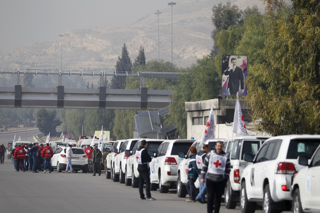 A convoy consisting of Red Cross, Red Crescent and United Nations agencies gathers in Damascus, Syria, before heading to Madaya, near the Lebanese border, and two villages Foua and Kefraya in the northwest of Syria on Jan. 11. Thousands are trapped in the besieged Syrian towns, and the United Nations says people are reported to have died of starvation. Photo by Omar Sanadiki/Reuters