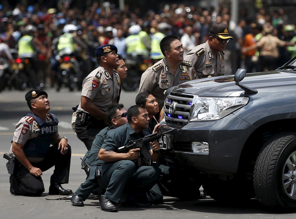 Police officers react near the site of a blast in Jakarta, Indonesia, Jan. 14, 2016. Photo by Darren Whiteside/Reuters
