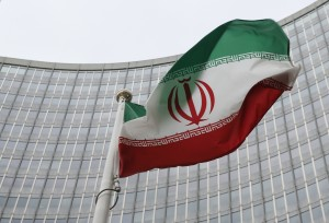 An Iranian flag flutters in front of the International Atomic Energy Agency (IAEA) headquarters in Vienna, Austria. Photo by Leonhard Foeger/Reuters