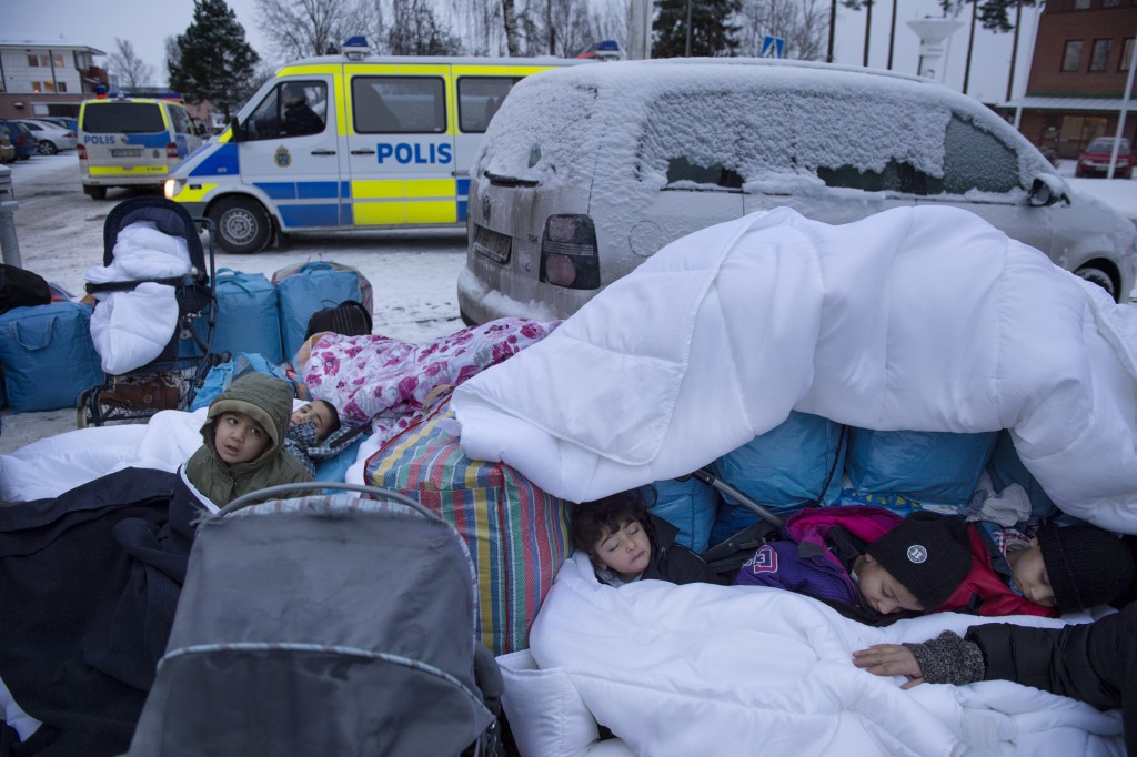 Children Nor, Saleh and Hajaj Fatema from Syria sleep near the Swedish Migration Board in Marsta, outside Stockholm, Sweden on January 8, 2016. Jessica Gow/Reuters