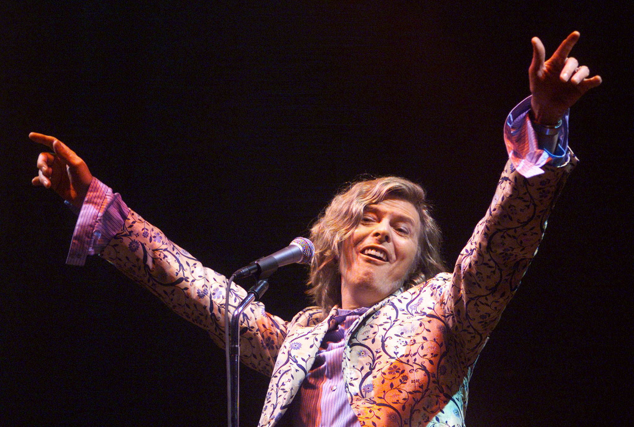 David Bowie headlines at the Glastonbury Festival June 25, 2000. Day three of the festival saw a performance by rock legend Bowie playing for the first time at Glastonbury since 1971, when the event was only in its second year.