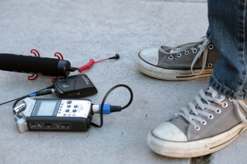 A student takes stock of audio equipment while on a shoot with Student Reporting Labs in Southern California.
