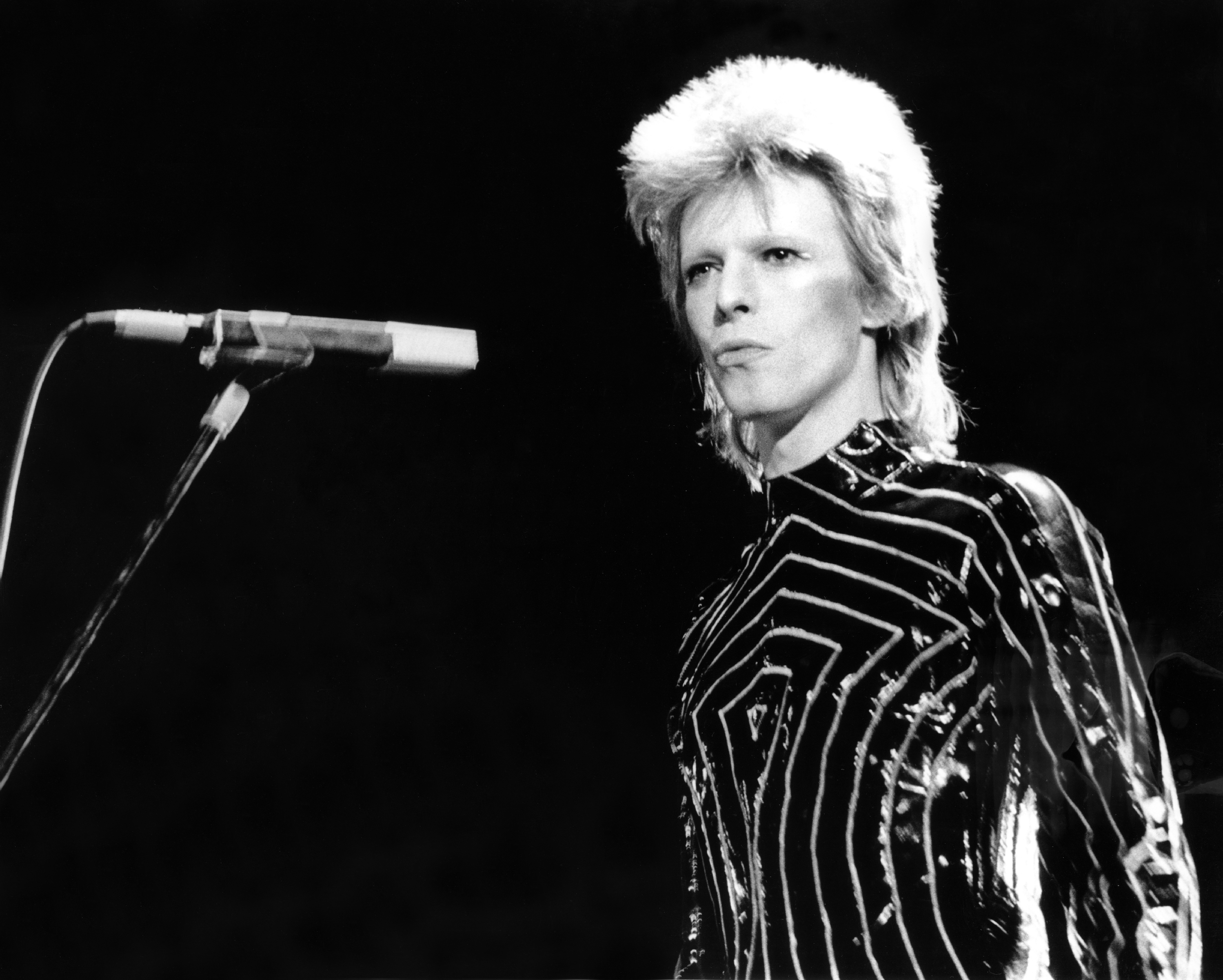 "Musician David Bowie performs onstage during his ""Ziggy Stardust"" era in 1973 in Los Angeles. The legendary music man died after an 18-month battle with cancer. He was 69. Photo by: Michael Ochs Archives/Getty Images"