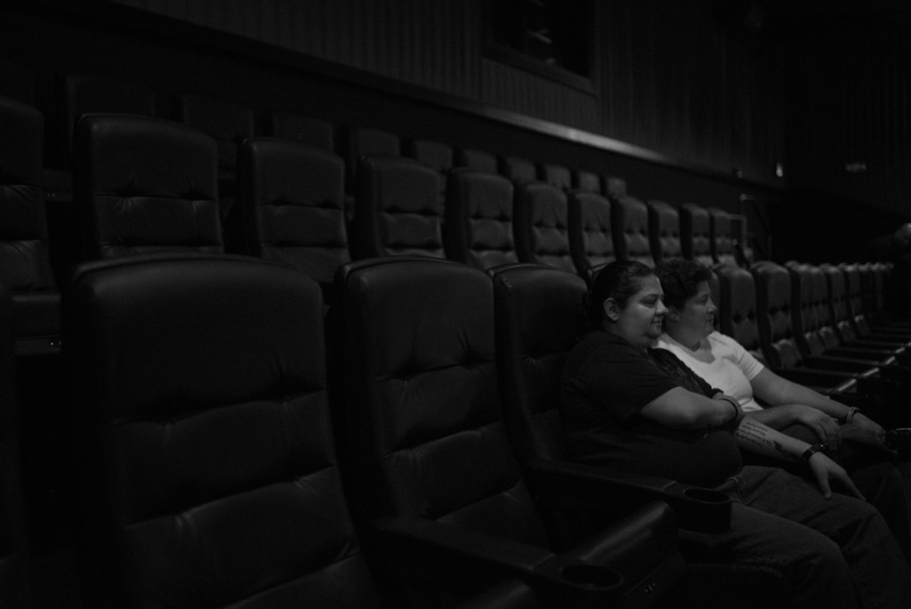 "Karen and Amy were watching ""The Dark Knight Rises"" in an Aurora, CO movie theater when the shooting began. While not physically wounded, they still bear emotional and psychological trauma. They still regularly attend movies at that theater and sit in the very same seats. Photo from ""It Takes Us"" photo series by Joe Quint"