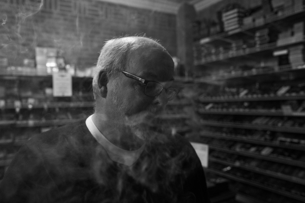 """Tom feels connected to his son Alex, also among those murdered in the Aurora theater shooting, when he visits the cigar bar where they used to go together. Photo from """"It Takes Us"""" photo series by Joe Quint"""