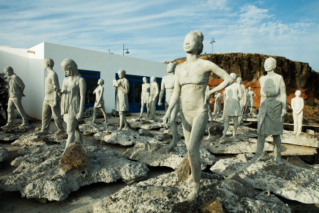 "Figures from ""Rubicon,"" part of Taylor's underwater sculpture exhibit, wait to be lowered underground off the coast of Lanzarote, Spain. Photo by Jason deCaires Taylor"