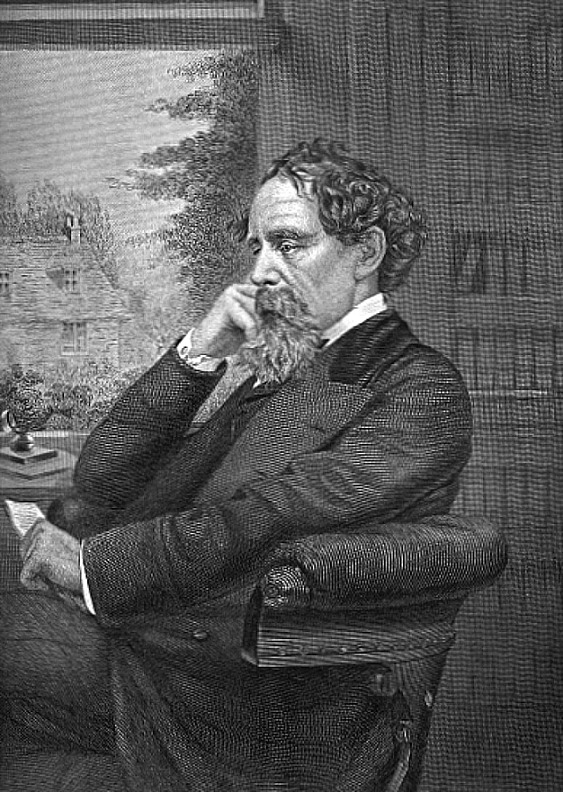 Charles Dickens at his desk, head in hand