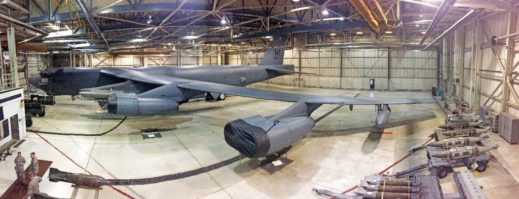 Panorama of a B-52H bomber inside a hangar at Minot Air Force Base, N.D. Inert training bombs sit on carts, at right, ready to be loaded onto the aircraft. These planes, first fielded in 1955, each can carry up to 70,000 lbs. of munitions. Photo by Dan Sagalyn