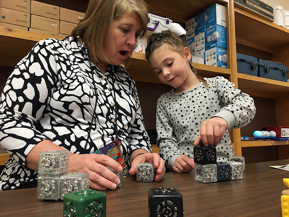 "Principal Janalyn Taylor exclaims as Layla Lee, 5, shows her how she's made a moving robot out of ""cubelets"" in the maker space at Nance Elementary in Clinton, Oklahoma. Photo: Lillian Mongeau"