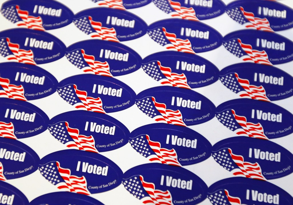 """I voted"" stickers are shown at a polling station during a special election for mayor in San Diego, California"