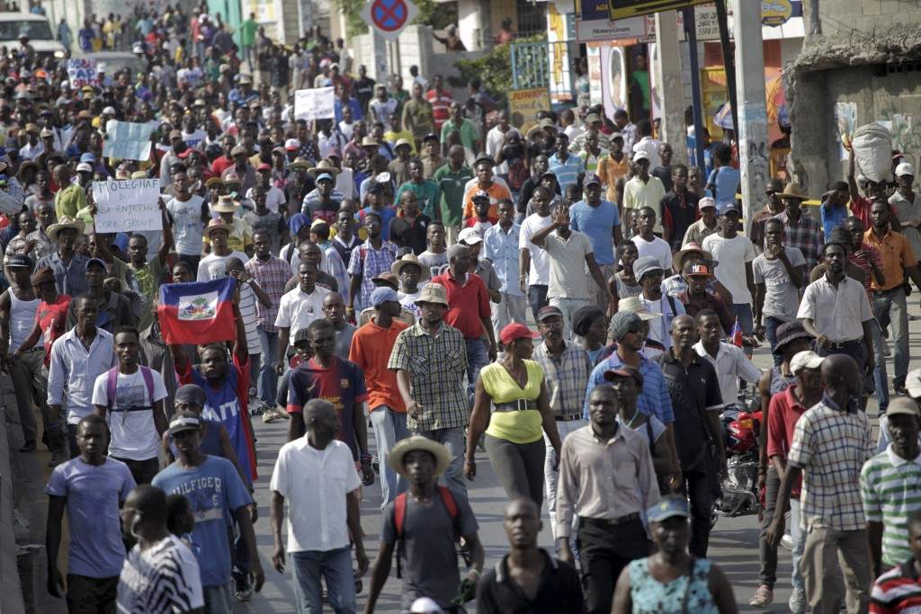 Protesters march during a demonstration against recent proposed changes to the electoral process in Port-au-Prince, Haiti, on Jan. 30, 2016. Photo by Andres Martinez Casares/Reuters