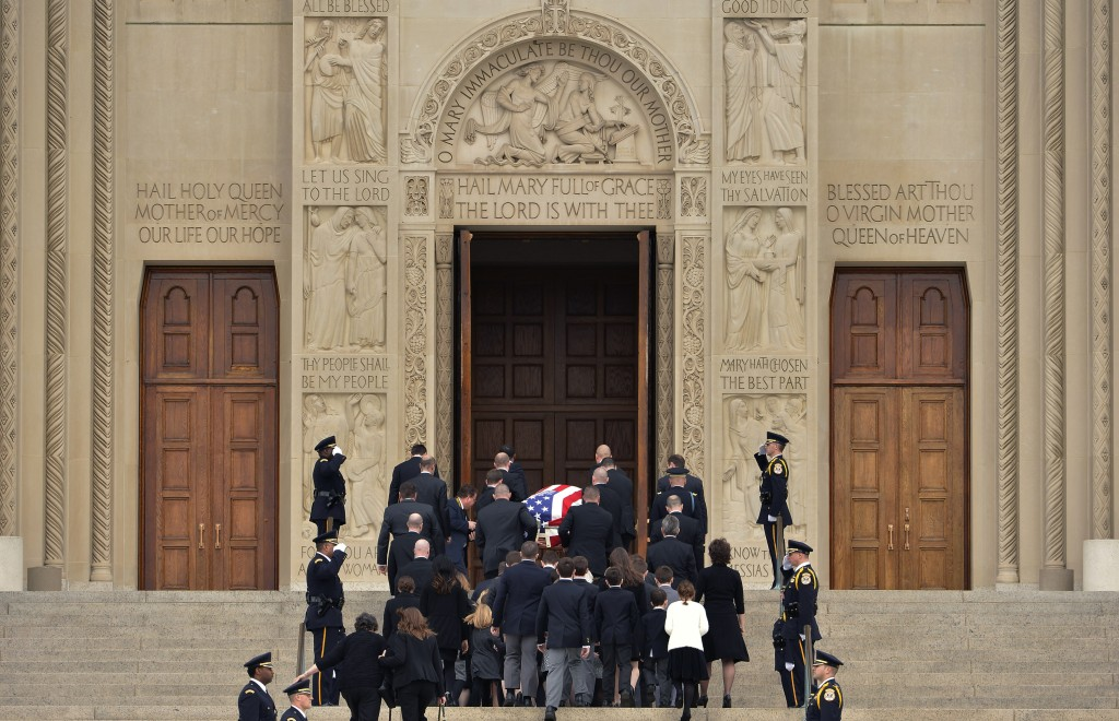 Pallbearers carry the casket of U.S. Supreme Court Associate Justice Antonin Scalia into his funeral mass at the Basilica of the National Shrine of the Immaculate Conception in Washington, February 20, 2016. REUTERS/Mike Theiler - RTX27TJC