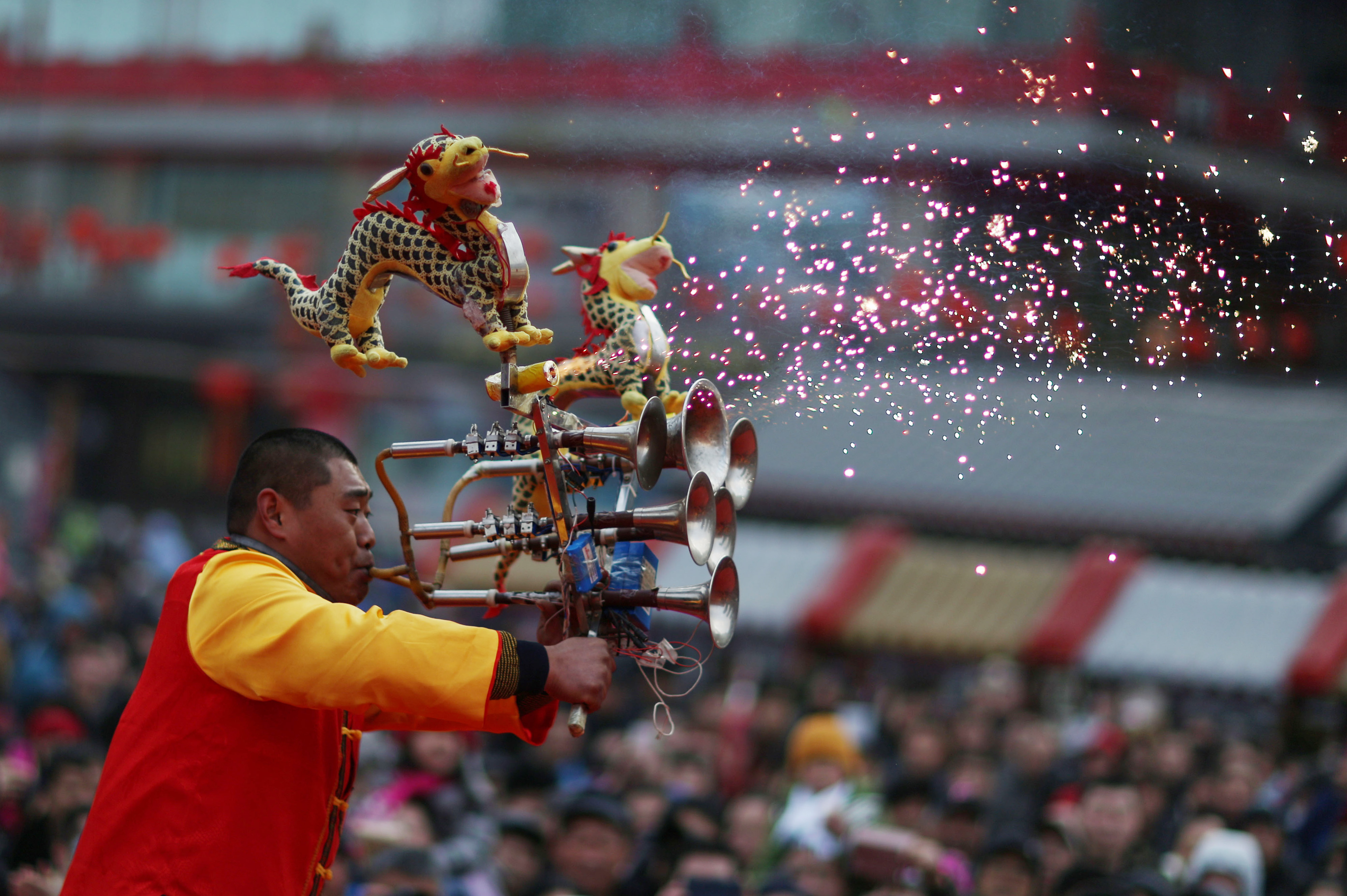 A man plays an instrument at a fair in the beginning of Chinese Lunar New Year at Huangsi Temple in Shenyang, Liaoning province, China on Feb. 8. Photo by Sheng Li/Reuters