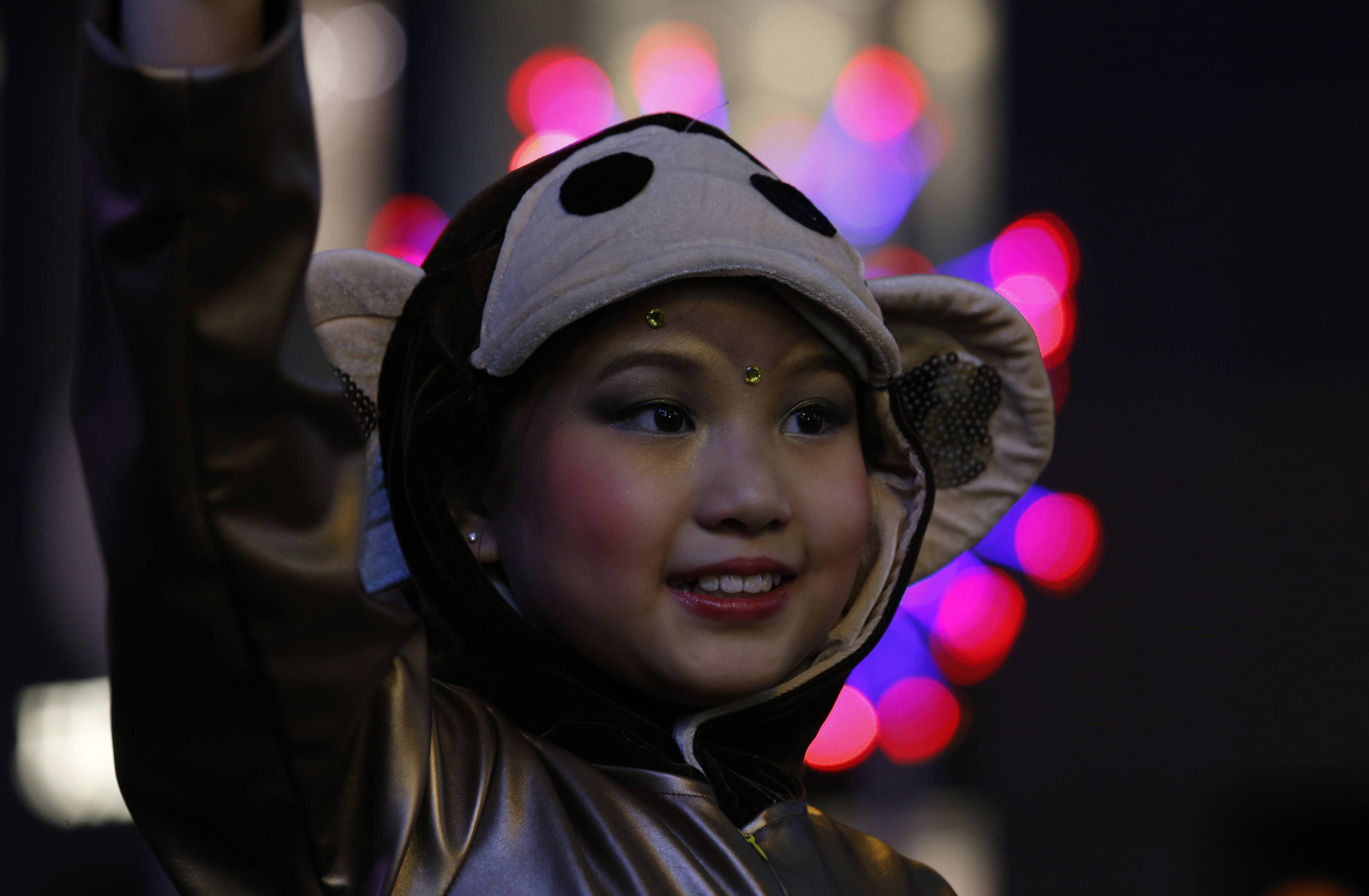 A young performer dressed as a monkey attends a parade celebrating the first day of the Lunar New Year of the Monkey in Hong Kong, China on Feb. 8. Photo by Bobby Yip/Reuters
