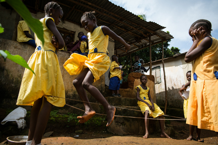 Students jump rope during recess at the We Yone School in George Brook, Freetown, Sierra Leone. Photo by Sara May