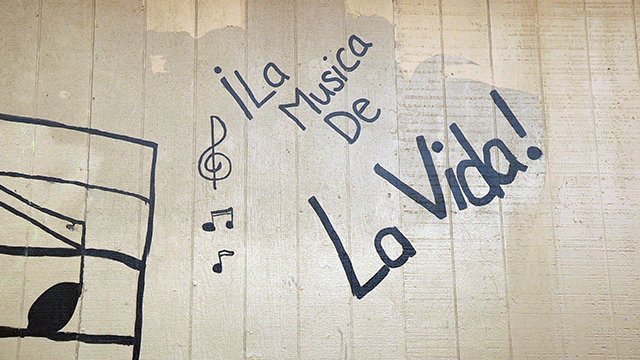 "Graffiti outside Garfield Elementary School in Yakima, Washington, reads ""Music is life."" Photo by Greg Davis, courtesy of KCTS."