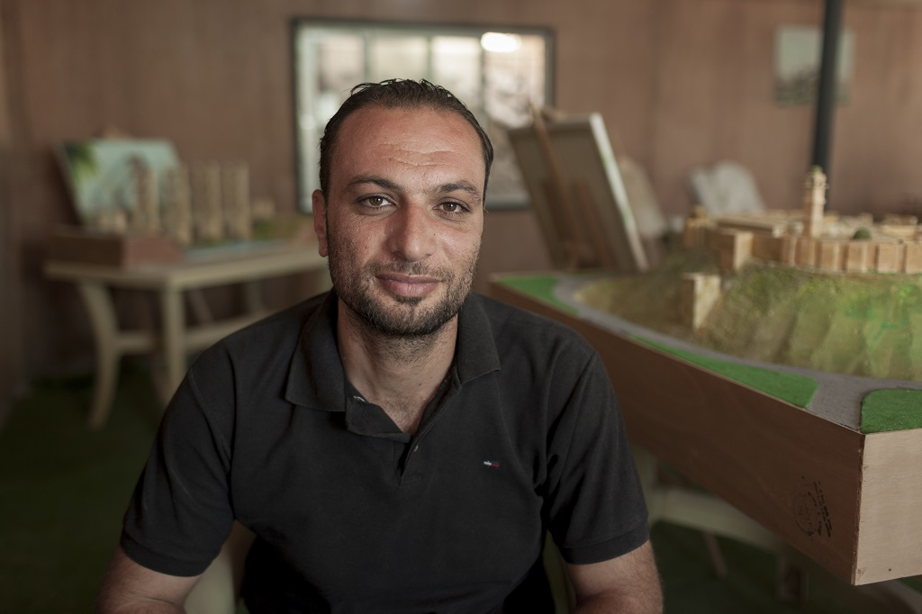 "Ahmad Hariri, who initially brought the group together and helps source their materials, says the project can help educate children in the camp about their homeland.  ""There are lots of kids living here who have never seen Syria or who have no memory of it. They know more about Jordan than about their own country."" The project has also given the artists themselves a sense of purpose. ""By doing this work, they feel like they are at least doing something to preserve their culture."" Photo © UNHCR/Christopher Herwig"