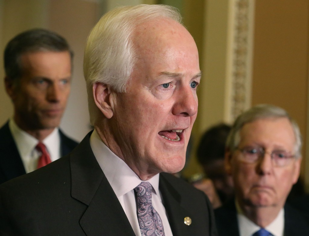 Sen. John Cornyn (R-TX) (C), speaks to the media while flanked by Senate Majority Leader Mitch McConnell (R-KY) (R), and Sen. John Thune (R-SD) (L), on February 2, 2016 in Washington, DC. The Senators discussed the comprehensive energy legislation that is currently before the Senate. (Photo by Mark Wilson/Getty Images)