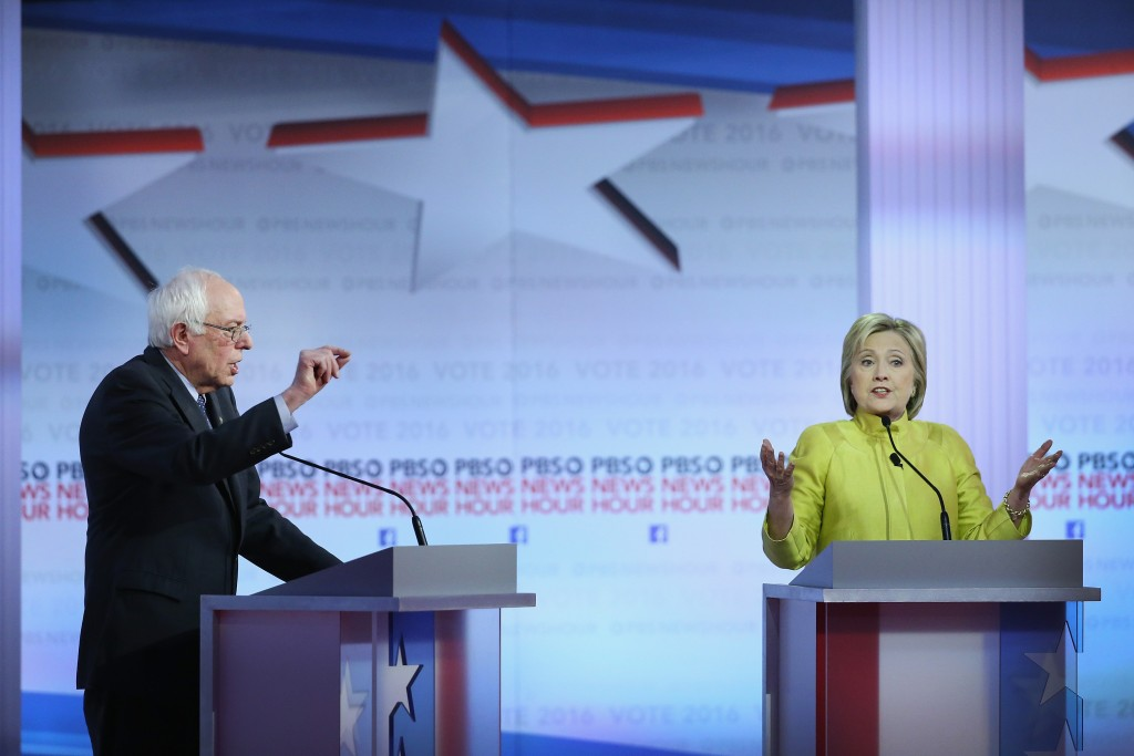 Democratic presidential candidates Senator Bernie Sanders (L) and Hillary Clinton participate in the PBS NewsHour Democratic presidential candidate debate at the University of Wisconsin-Milwaukee on February 11, 2016 in Milwaukee, Wisconsin. The rivals will be meeting again on Sunday night in Flint, Mich. Win McNamee/Getty Images