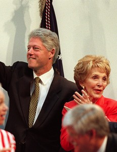 President Clinton waves with Reagan at a dedication ceremony of the new Ronald Reagan Building and International Trade Center in May 2005 in Washington. Photo by Stephen Jaffe/Getty Images.