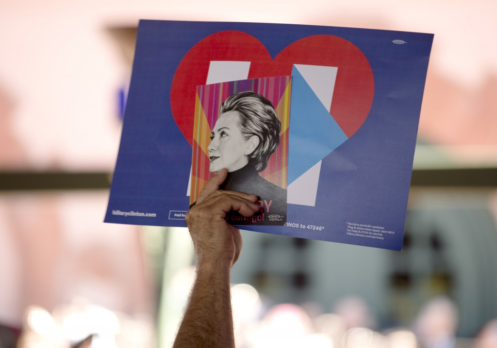 A Clinton supporter holds up a sign while waiting for Democratic presidential candidate Hillary Clinton to speak during a rally in San Antonio, Texas. Photo by Darren Abate/Reuters