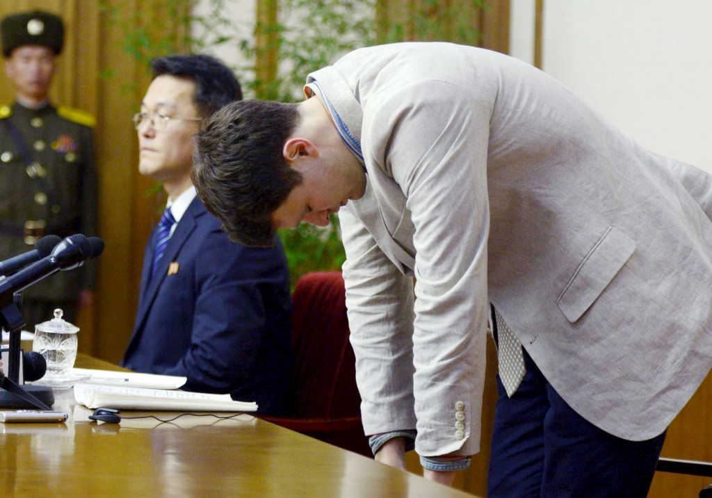 """Otto Frederick Warmbier, a University of Virginia student who has been detained in North Korea since early January 2016, bows during a news conference in Pyongyang, North Korea, in this photo released by Kyodo on Feb. 29, 2016. Warmbier was detained for allegedly trying to steal a propaganda banner from his Pyongyang hotel and has confessed to """"severe crimes"""" against the state, the North's official media said on Monday. Photo by Kyodo via Reuters"""