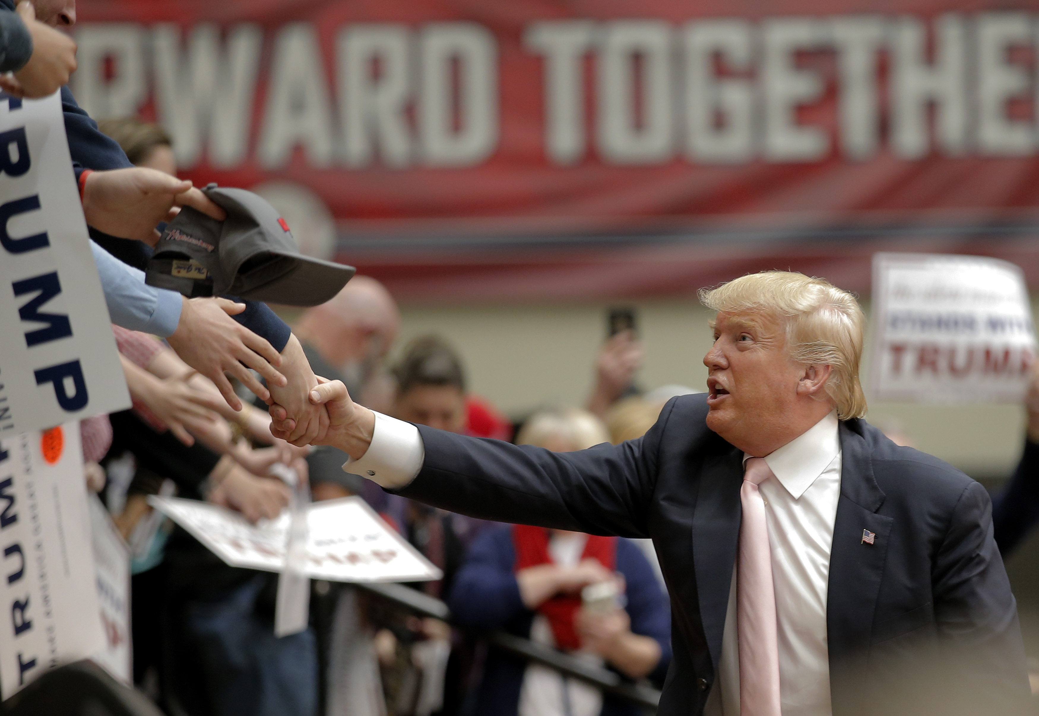 Republican presidential candidate Donald Trump shakes hands with supporters following a campaign event in Radford, Virginia. Photo by Chris Keane/Reuters