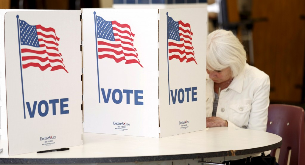 Proposed fixes to Social Security and the effects the tax cuts could have on Medicare and Medcaid are two issues voters should consider when heading to the polls, writes Philip Moeller. Photo by Kevin Lamarque/Reuters