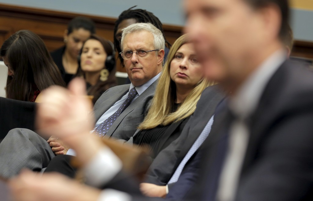 """Bruce Sewell, senior vice president and general counsel for Apple Inc., watches as FBI Director James Comey testifies during a House Judiciary hearing on """"The Encryption Tightrope: Balancing Americans' Security and Privacy"""" on Capitol Hill in Washington, D.C. Photo by Joshua Roberts/Reuters"""