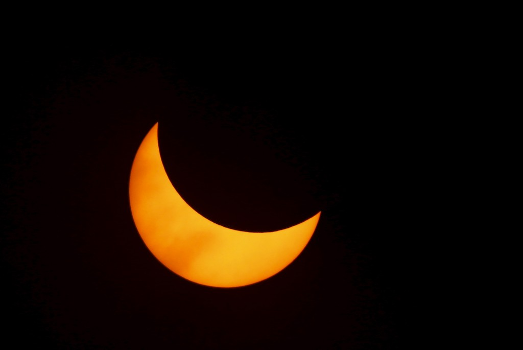 A solar eclipse is seen from the beach of Ternate island, Indonesia, March 9, 2016.  Photo by Beawiharta/Reuters