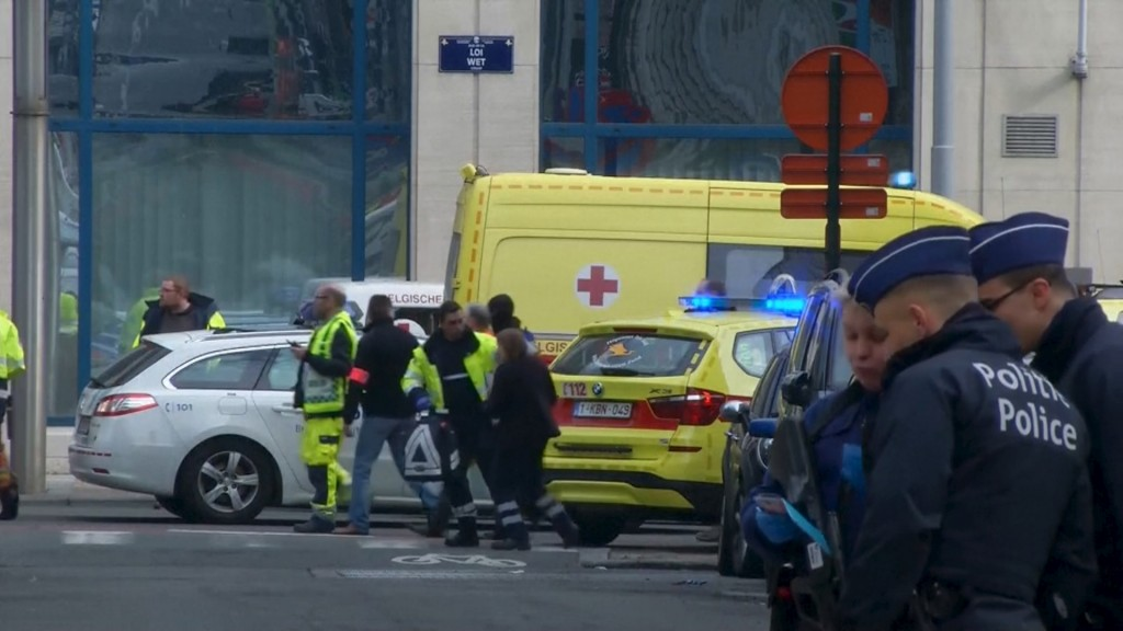 Emergency personnel are seen at the scene of a blast outside a metro station in Brussels in this still image taken from video on March 22. Photo by Reuters TV