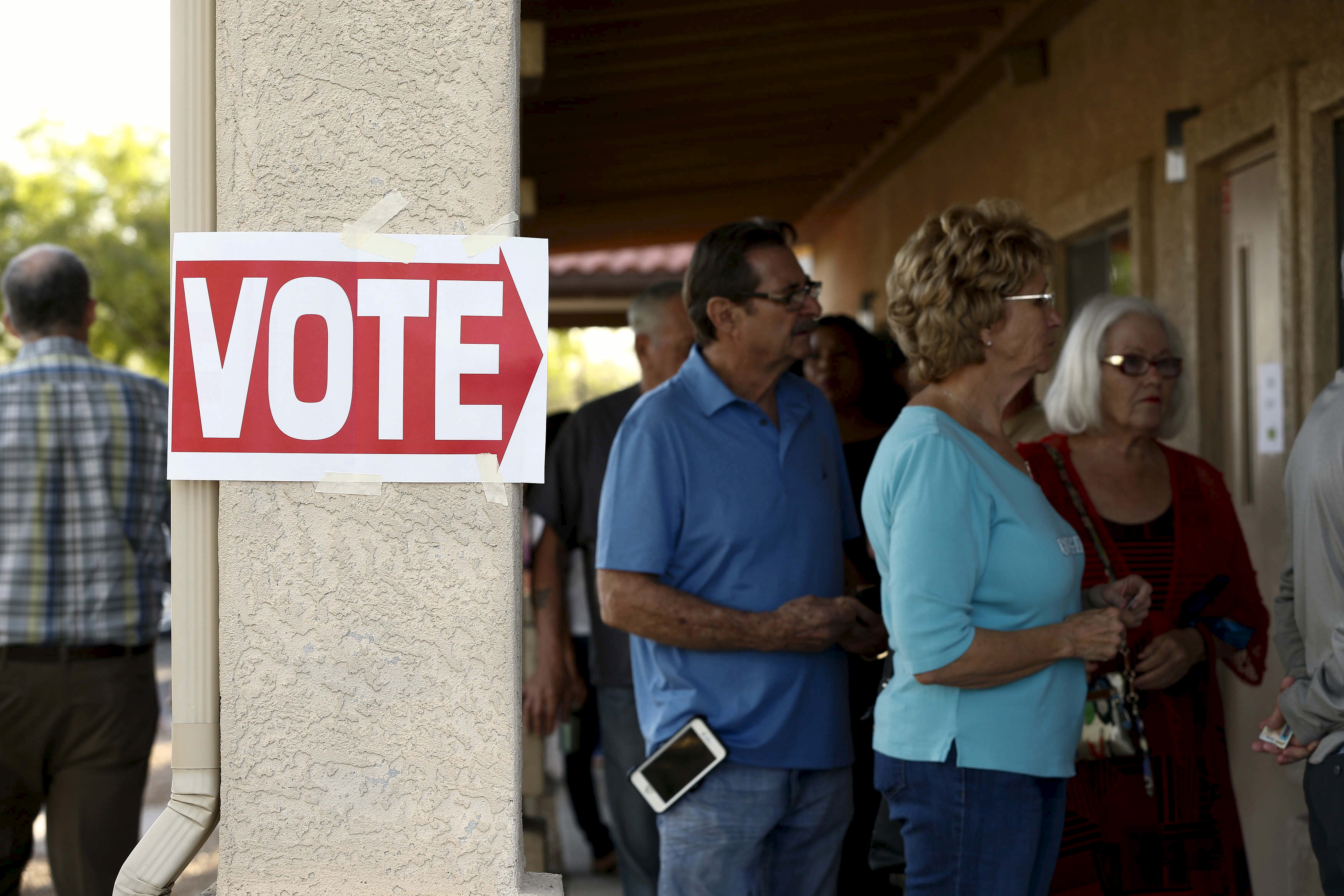 People wait to vote in the U.S. presidential primary election at a polling site in Glendale, Arizona March 22, 2016. Photo by Nancy Wiechec/Reuters