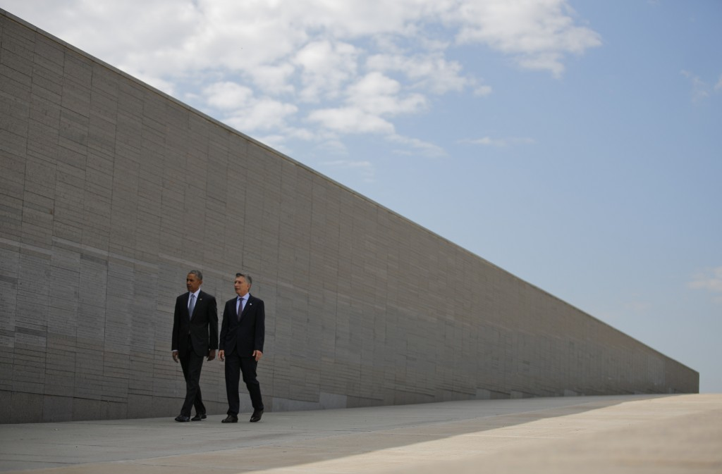 "U.S. President Barack Obama (left) and Argentina's President Mauricio Macri visit Parque de la Memoria (Remembrance Park), where they honored victims of Argentina's ""Dirty War"" on the 40th anniversary of the 1976 coup that initiated the period of military rule, in Buenos Aires, on March 24. Photo by Carlos Barria/Reuters"